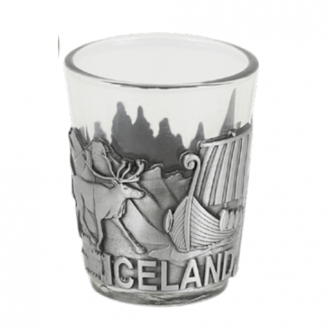 Shot glass with viking themed silver colored iron frame