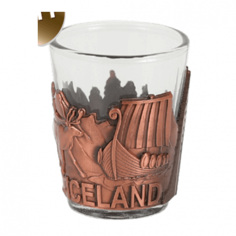 Shot glass with viking themed copper colored iron frame