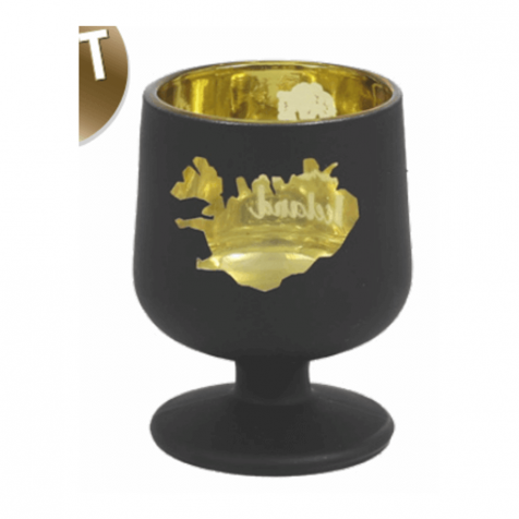Shot glass in black and gold with map of Iceland and volcano